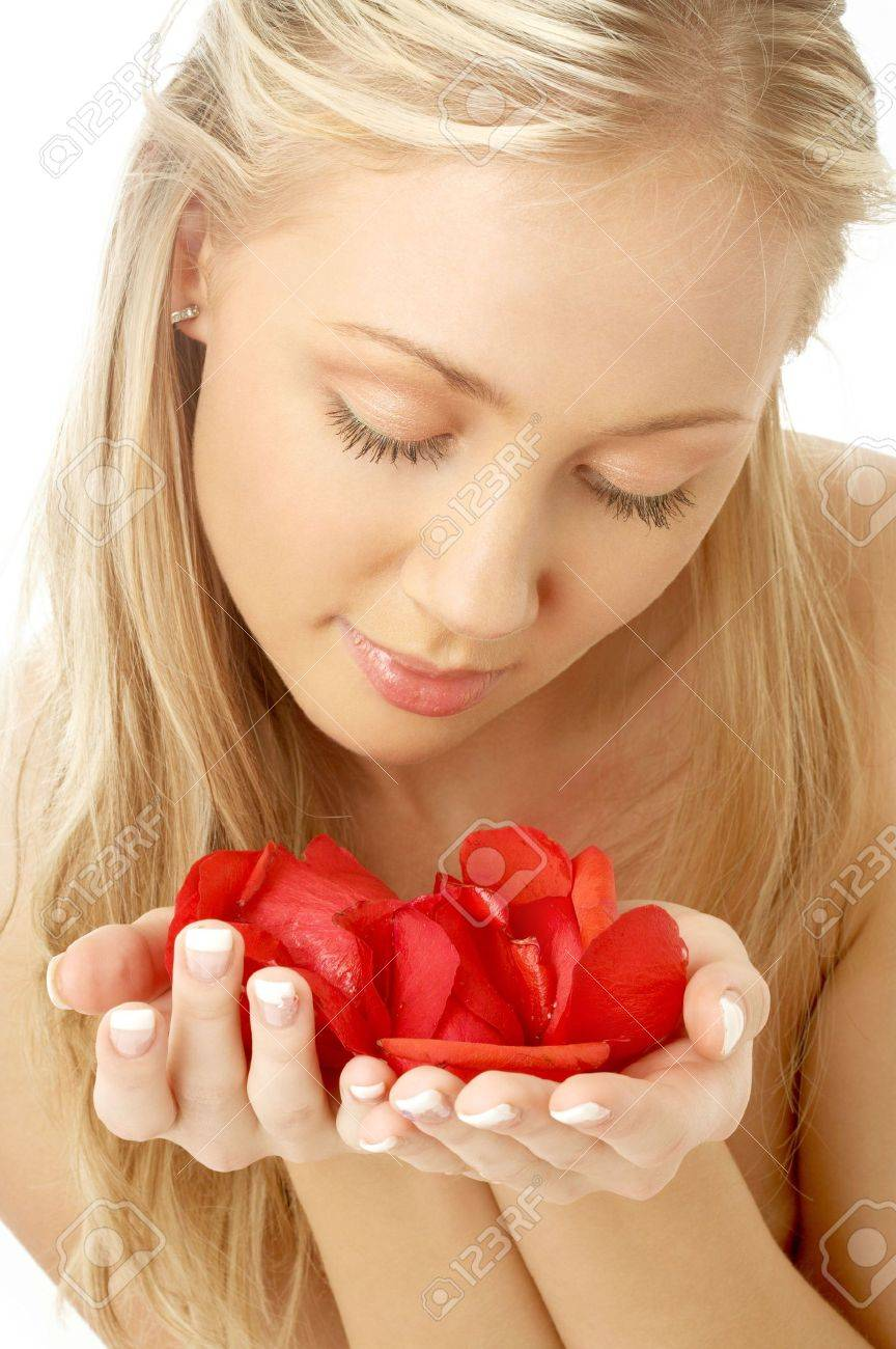 portrait of lovely blond in spa with red rose petals Stock Photo - 843748
