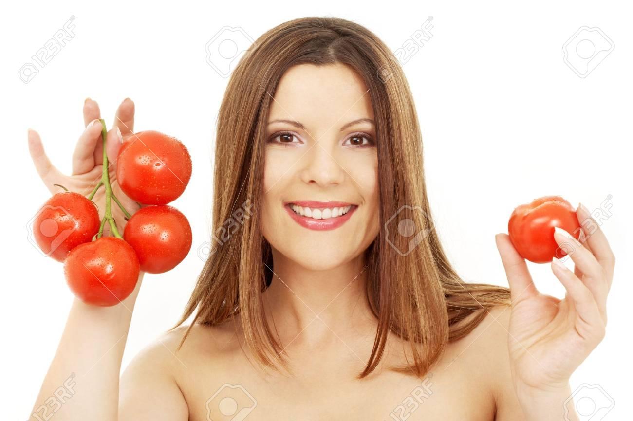 beautiful brunette girl holding tomatos over white Stock Photo - 1068232