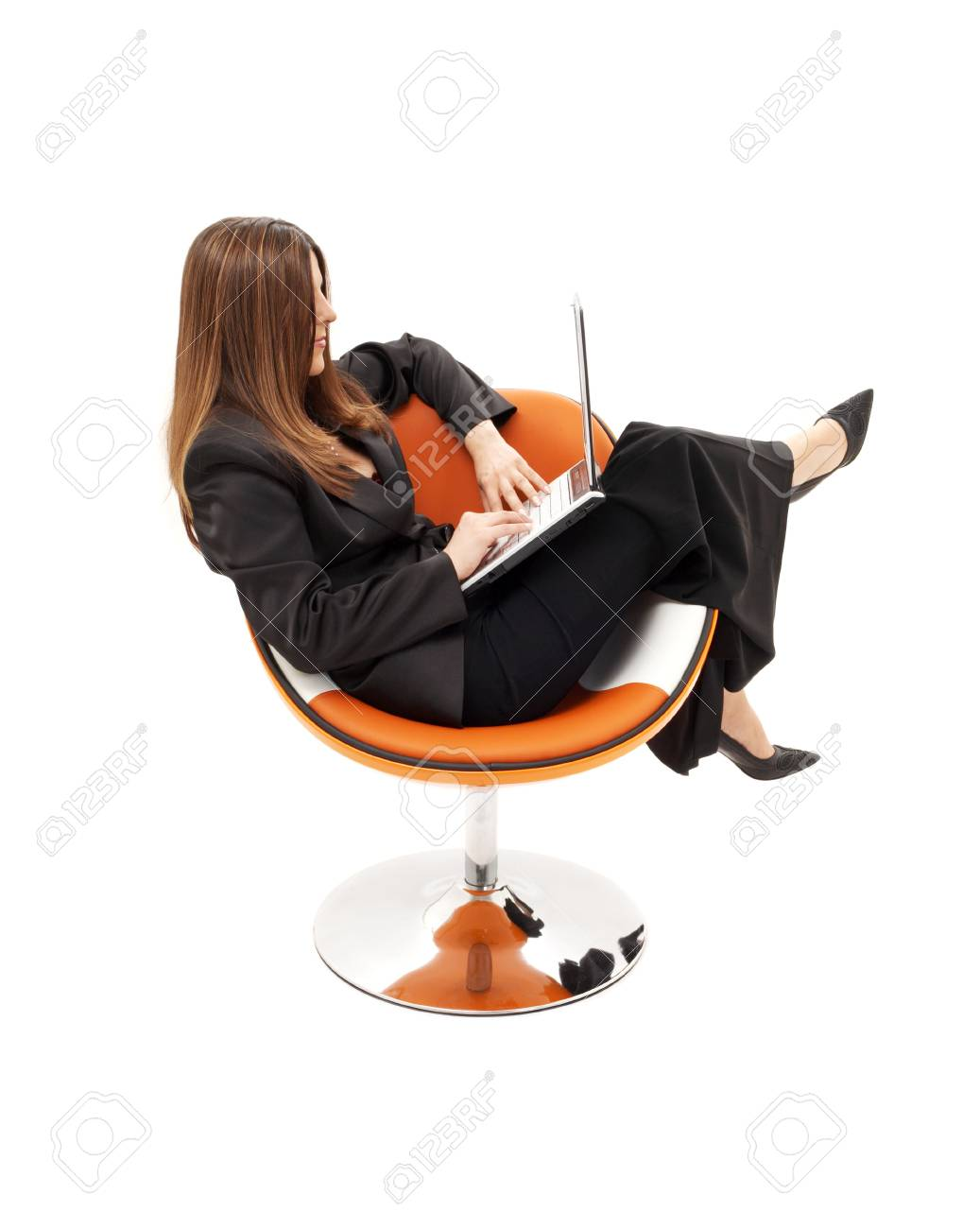 businesswoman with laptop in orange chair over white Stock Photo - 1193634