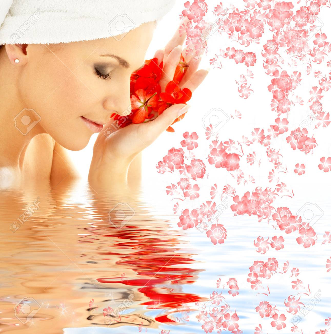 lovely woman with red flower petals in water Stock Photo - 1566702