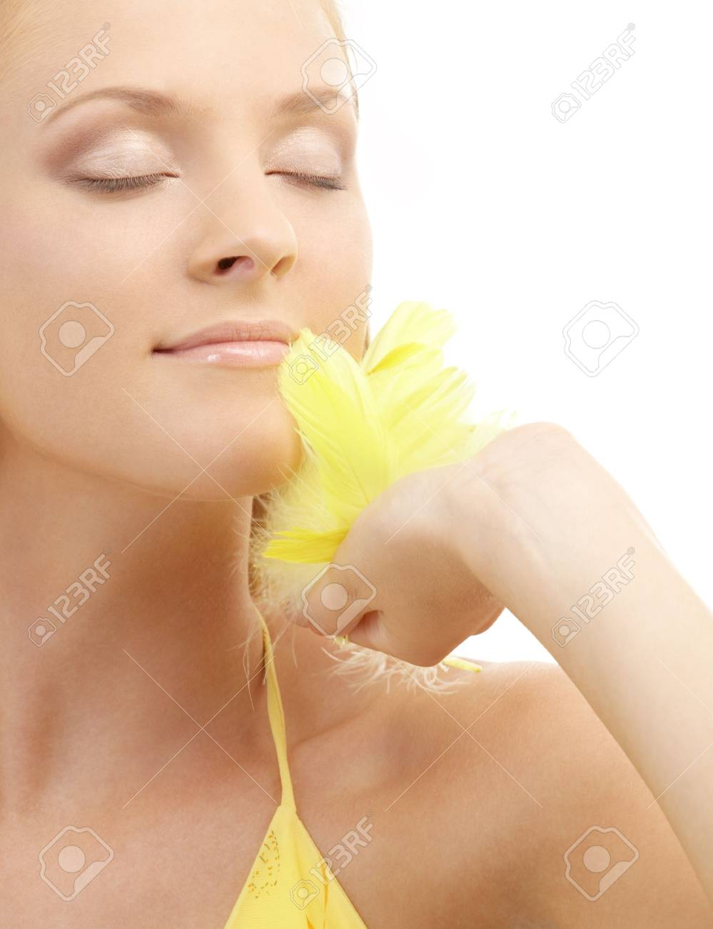 portrait of woman with yellow feathers over white background Stock Photo - 1962027