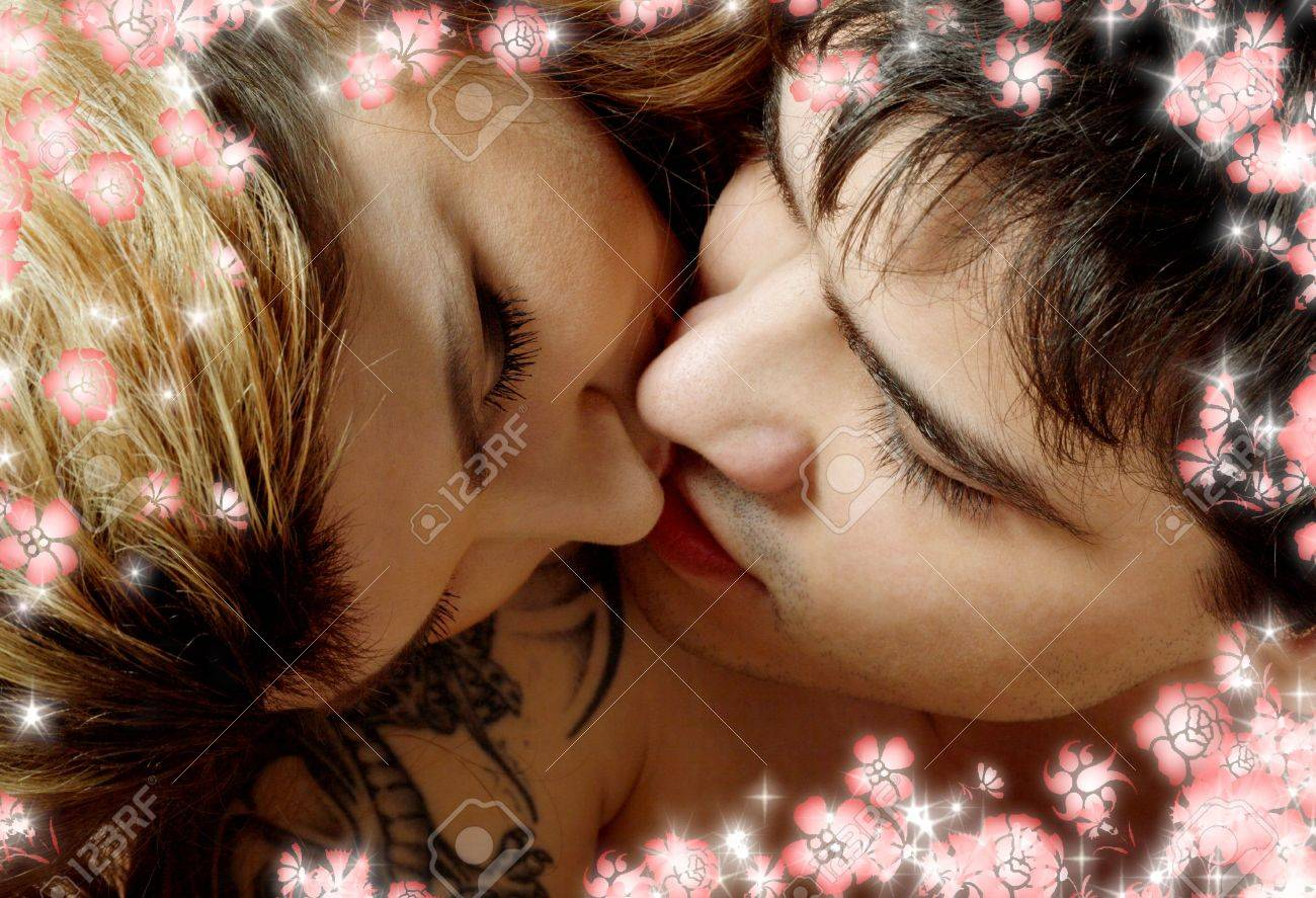 picture of sweet couple kissing in bed with flowers Stock Photo - 2360822