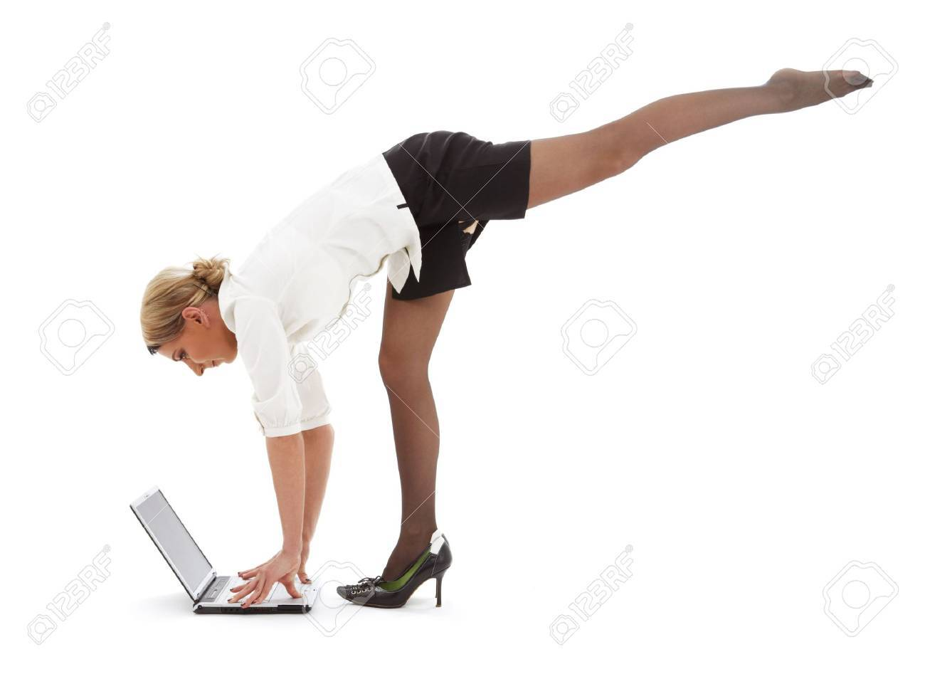 flexible businesswoman with laptop computer over white Stock Photo - 2397310