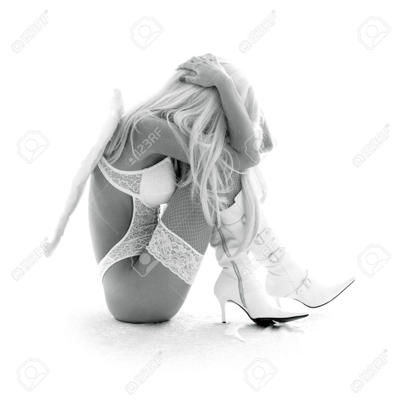 monochrome picture of depressed angel girl over white Stock Photo - 2504275
