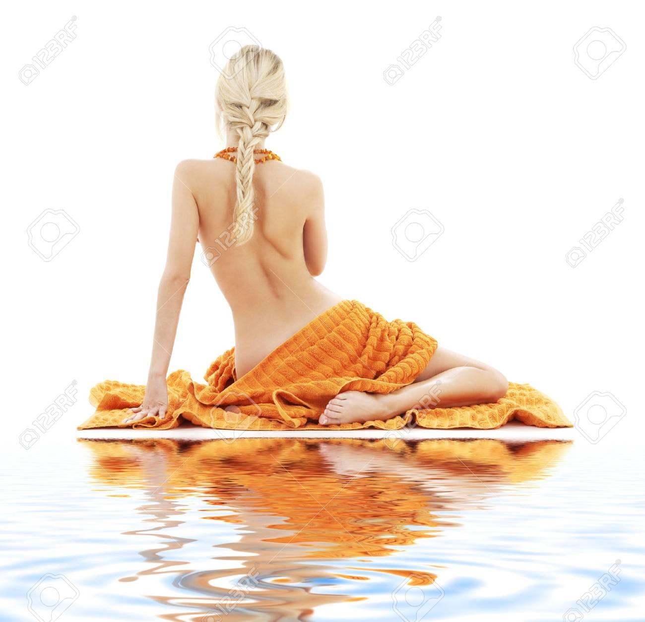 picture of beautiful lady with orange towels on white sand Stock Photo - 2586501
