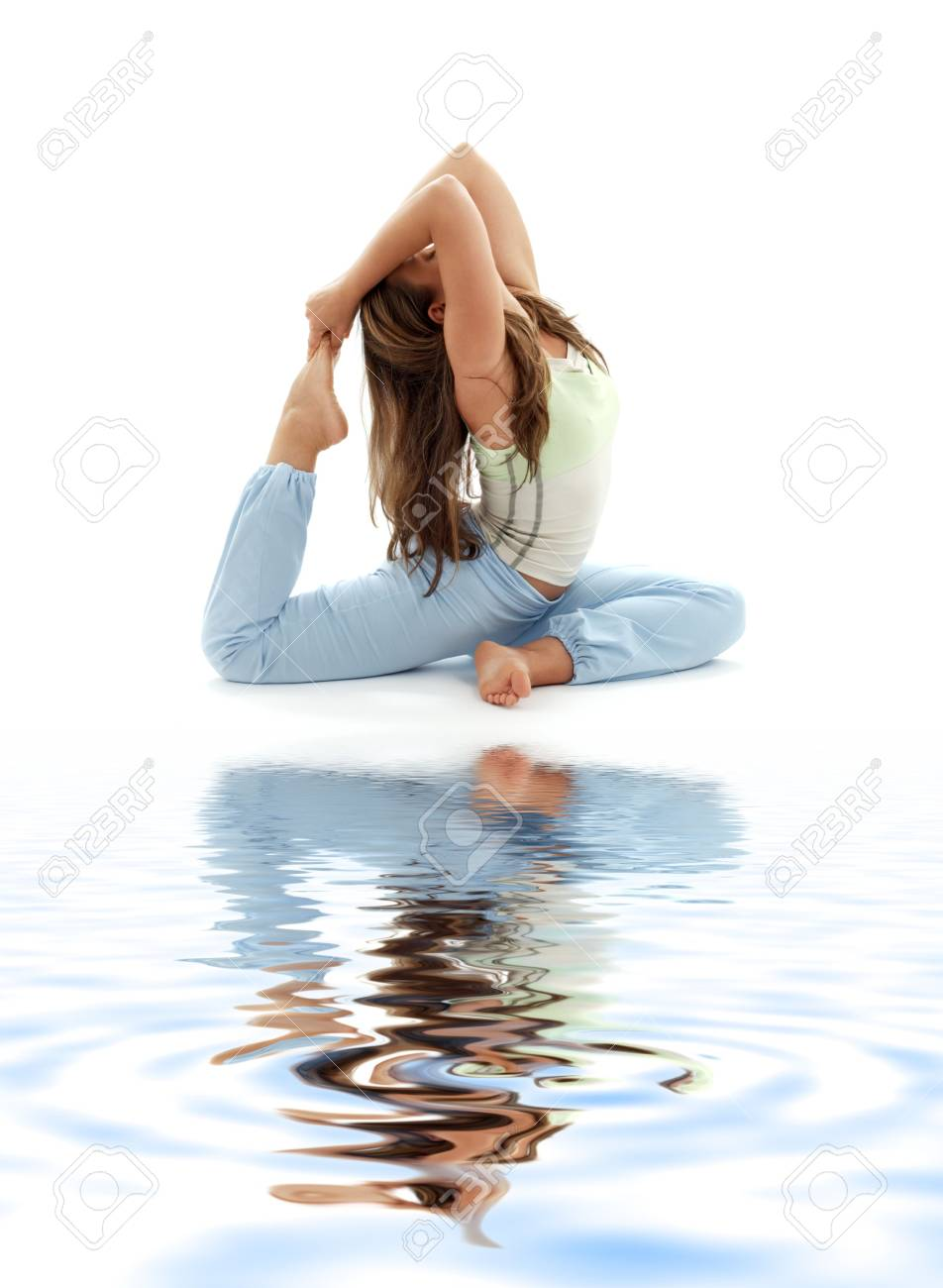 lovely girl practicing ashtanga yoga on white sand Stock Photo - 2623720