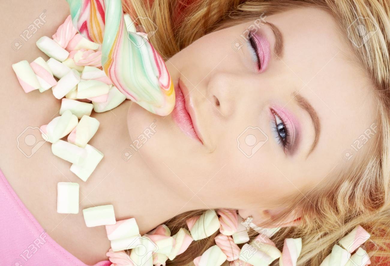 picture of blond girl with big lollipop and candies Stock Photo - 2746652