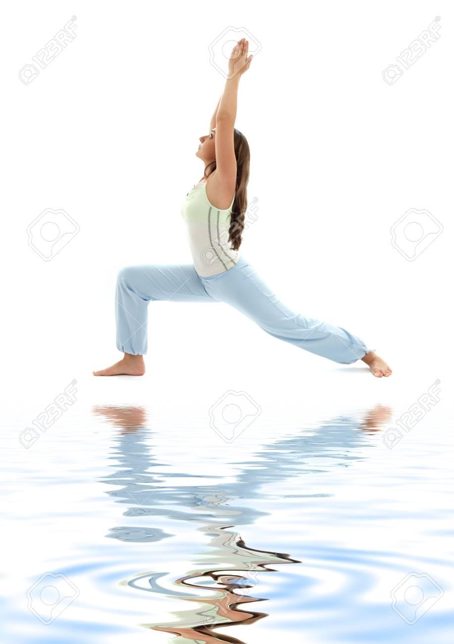 sporty girl practicing virabhadrasana warrior pose on white sand Stock Photo - 2847240
