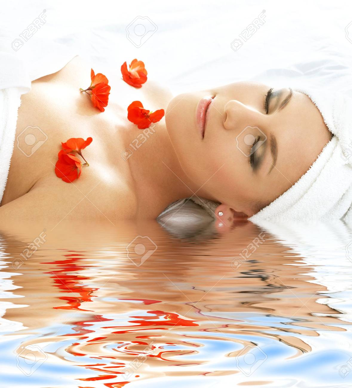 beautiful lady with red flowers in spa Stock Photo - 2886046