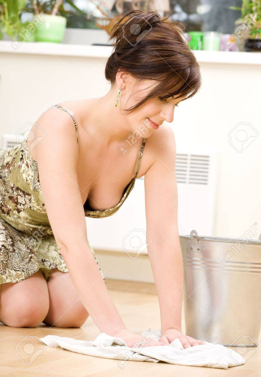 bright picture of lovely housewife cleaning floor Stock Photo - 3199979