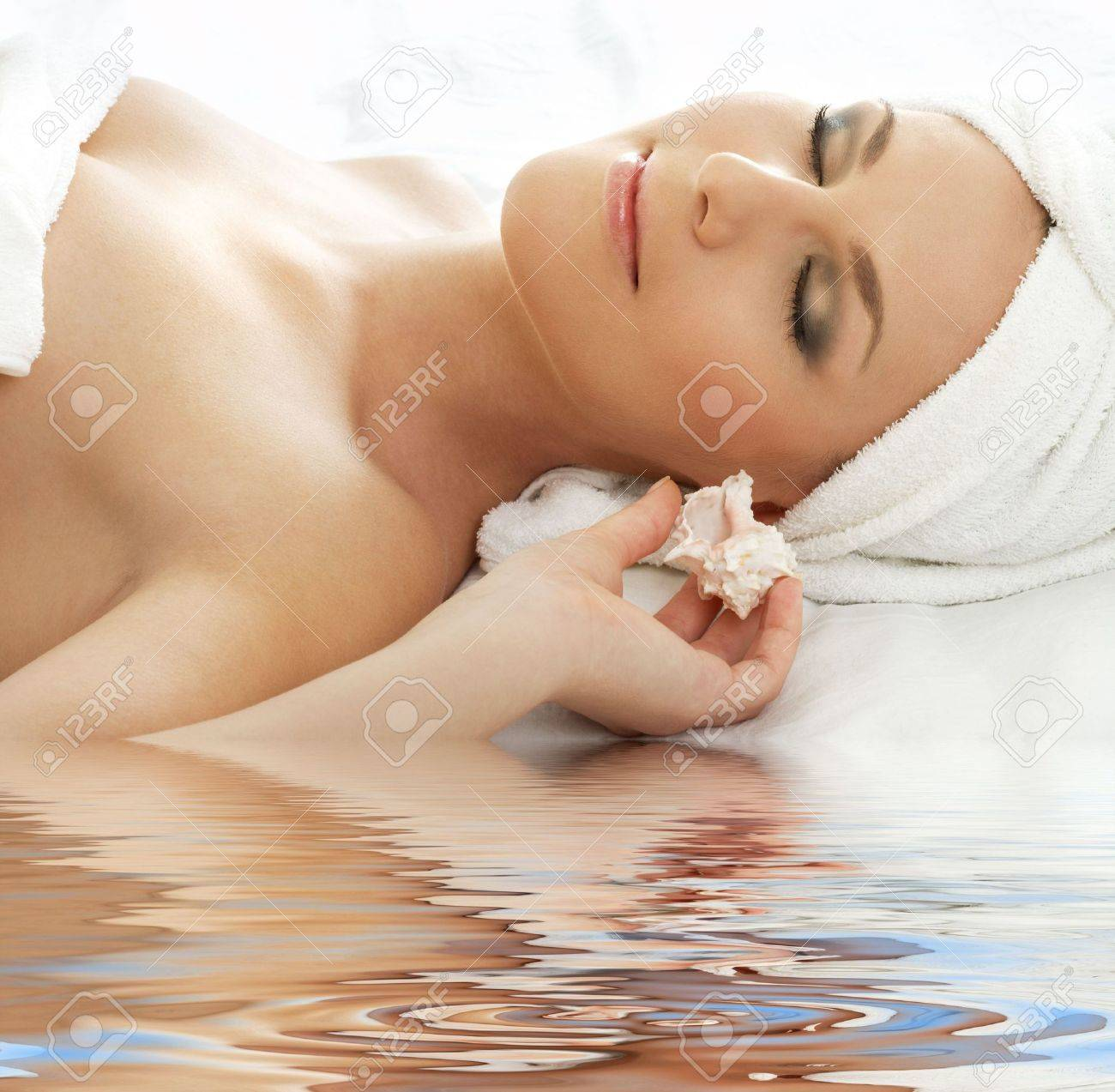 beautiful lady with sea shell in spa Stock Photo - 3465088