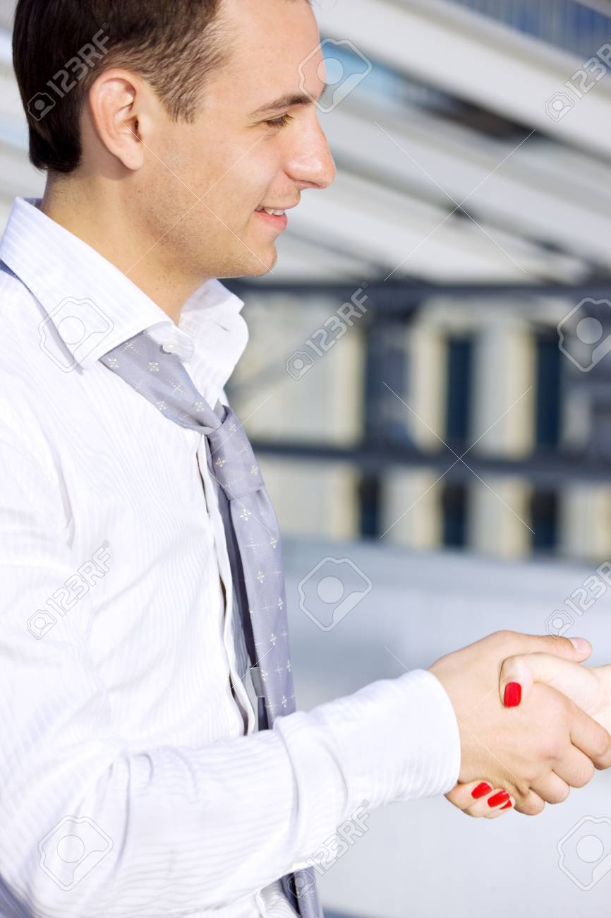 picture of handsome businessman shaking hands with female colleague Stock Photo - 3465173