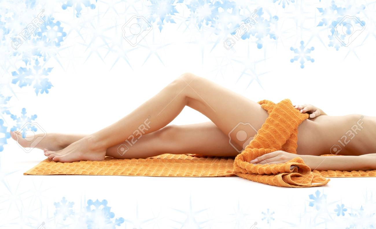 long legs of relaxed lady with orange towel and snowflakes Stock Photo - 3474819