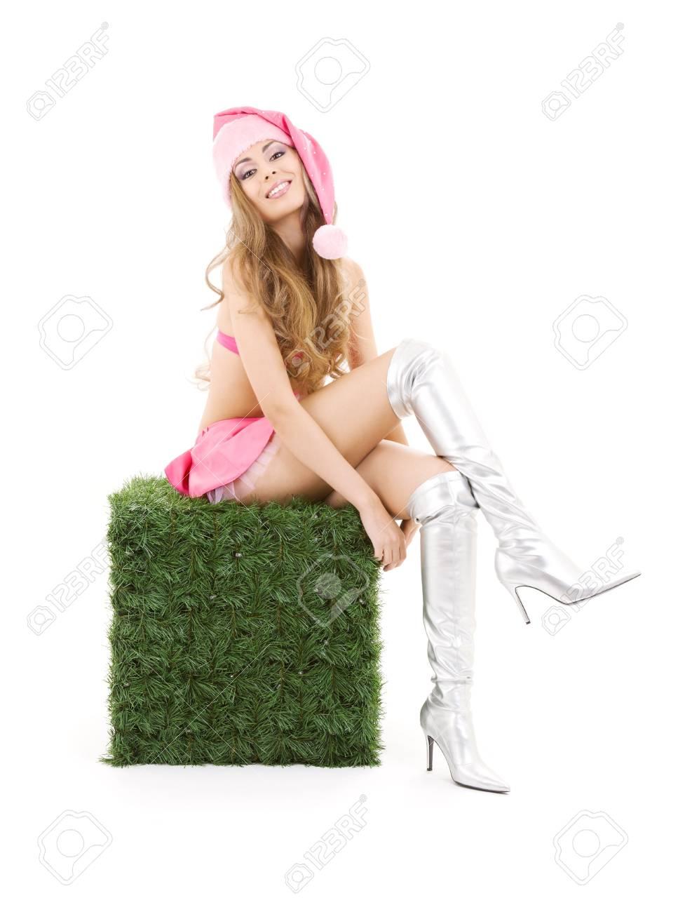 sexy santa helper sitting on green cube over white Stock Photo - 3641370