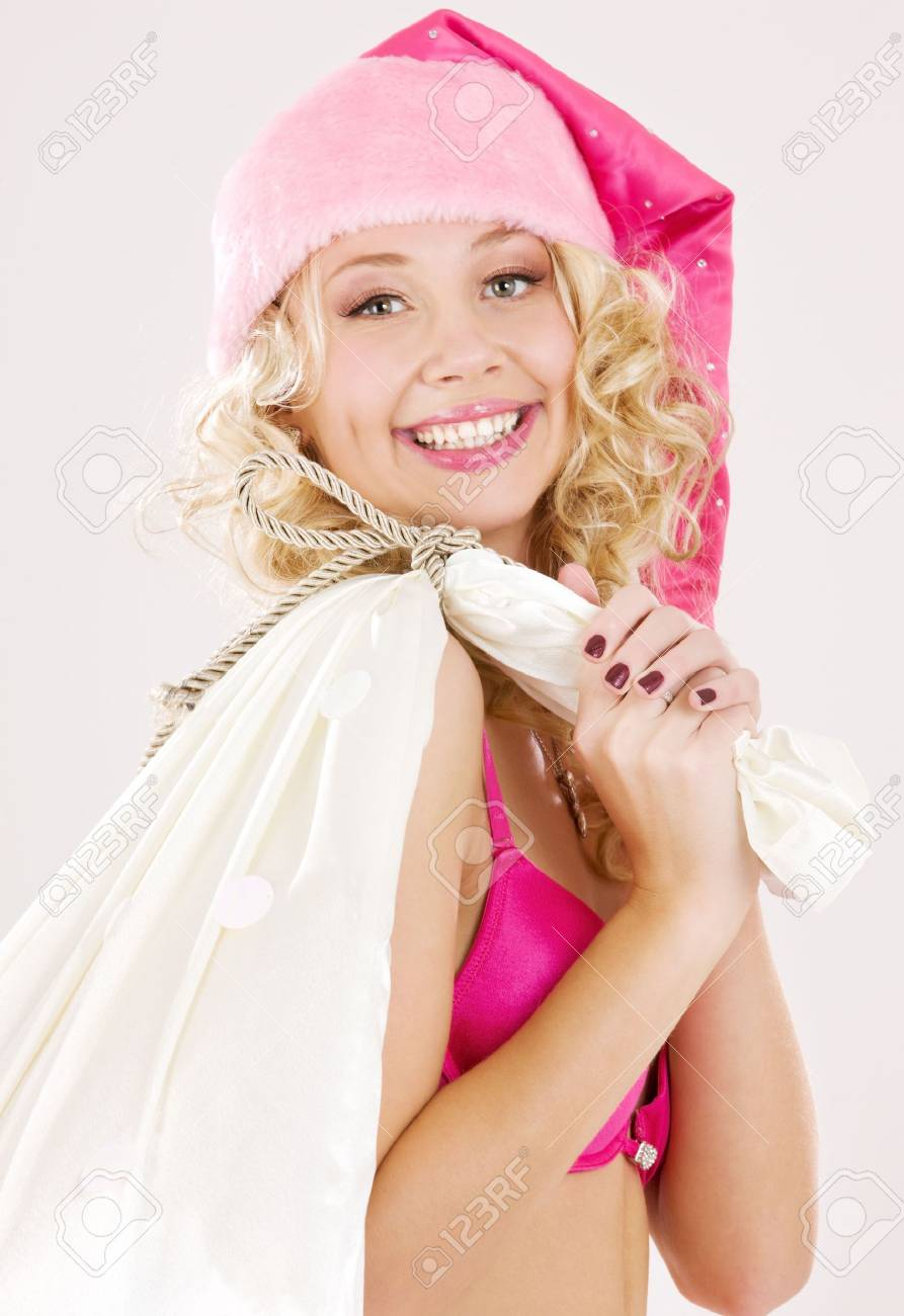 picture of cheerful santa helper girl with big bag Stock Photo - 3641584