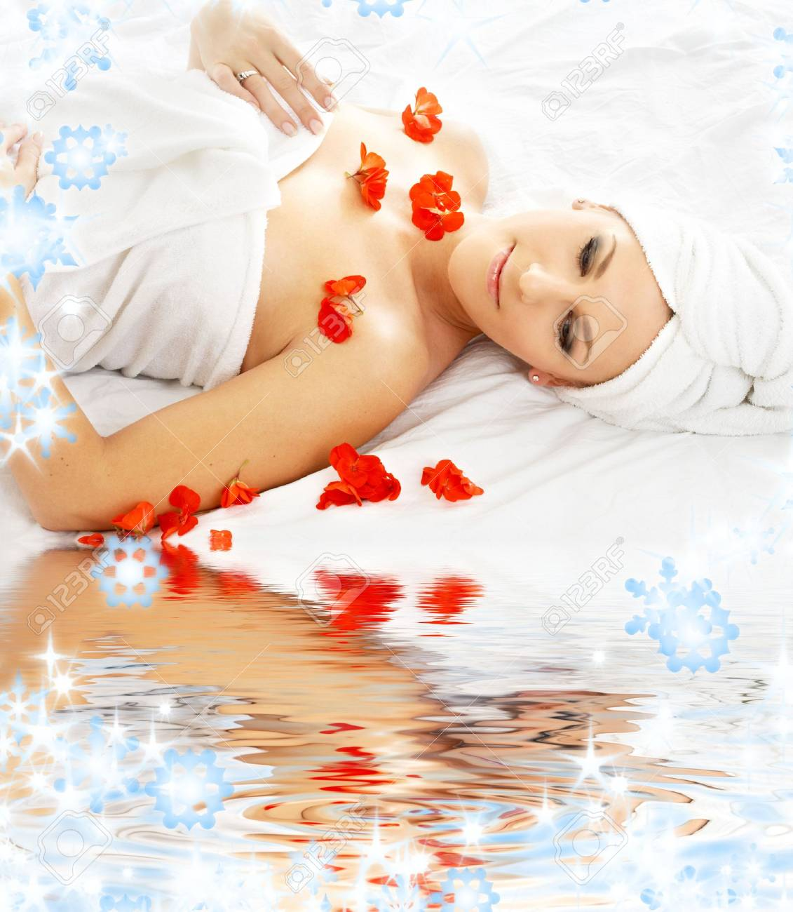 beautiful lady with red flower in spa with water Stock Photo - 3673114