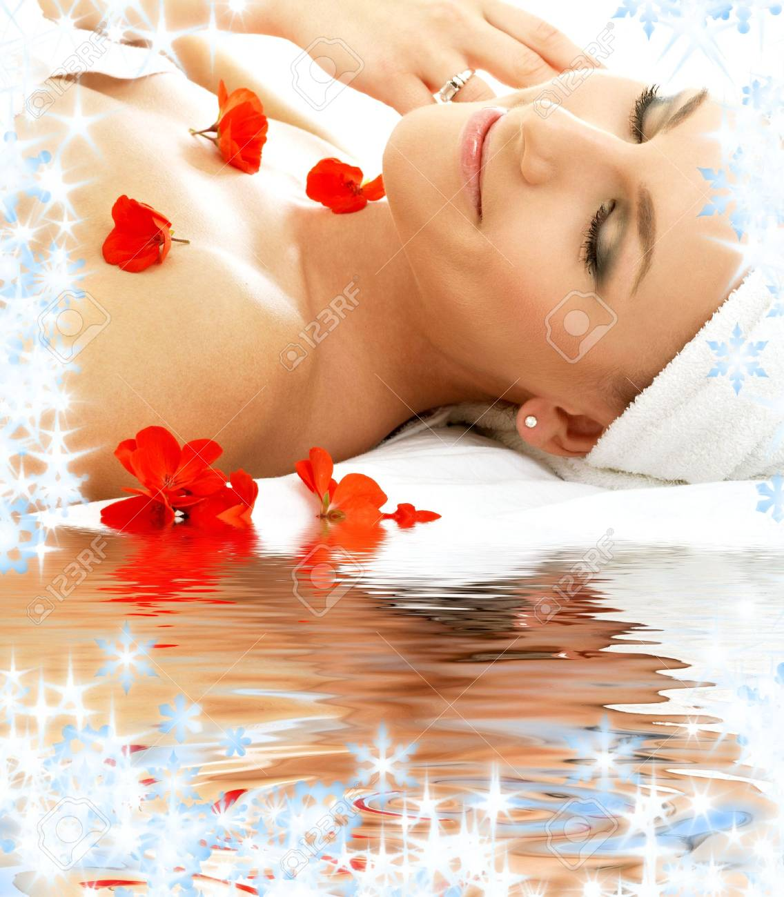 beautiful lady with red flowers in spa Stock Photo - 3701651