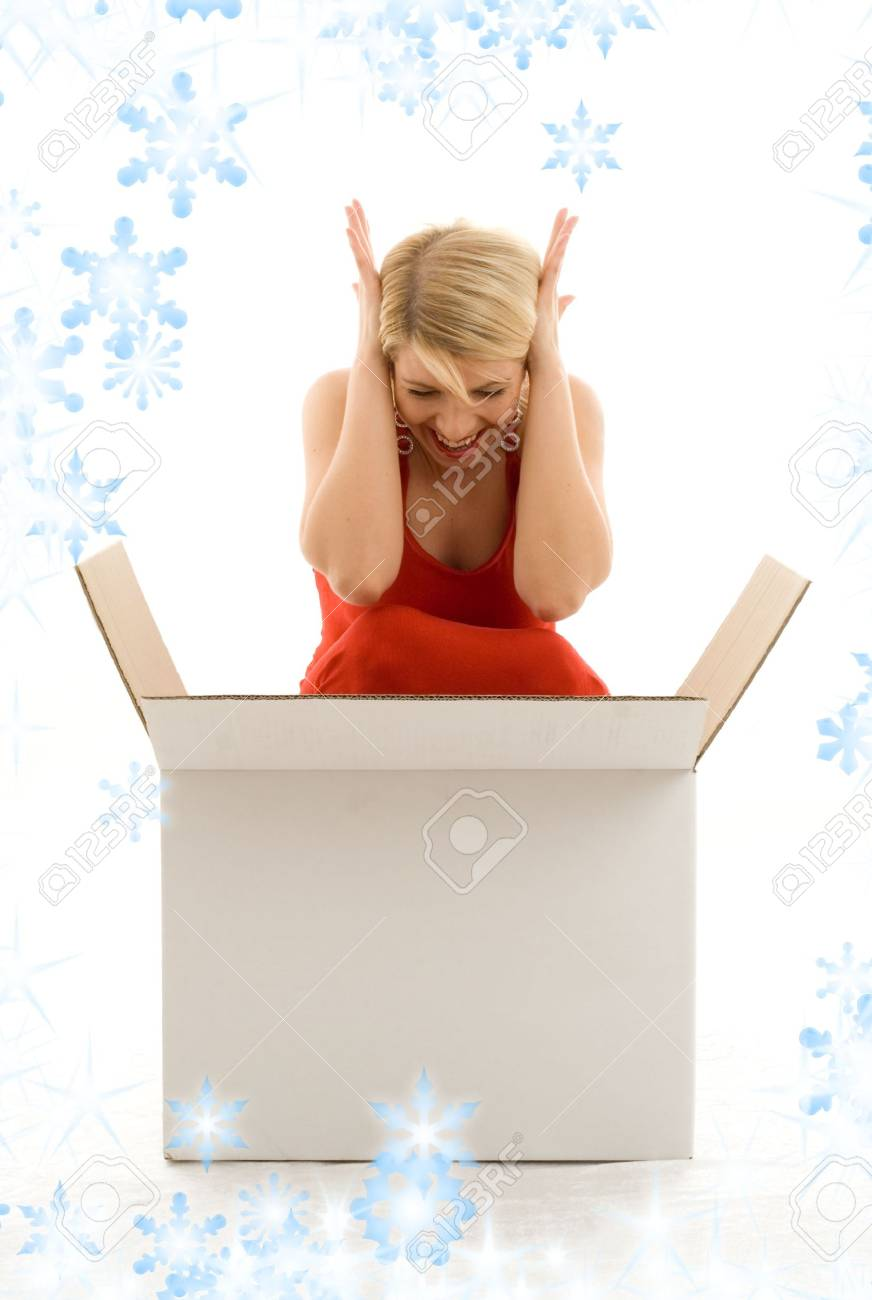happy girl in red dress with big blank white box and snowflakes Stock Photo - 3898362