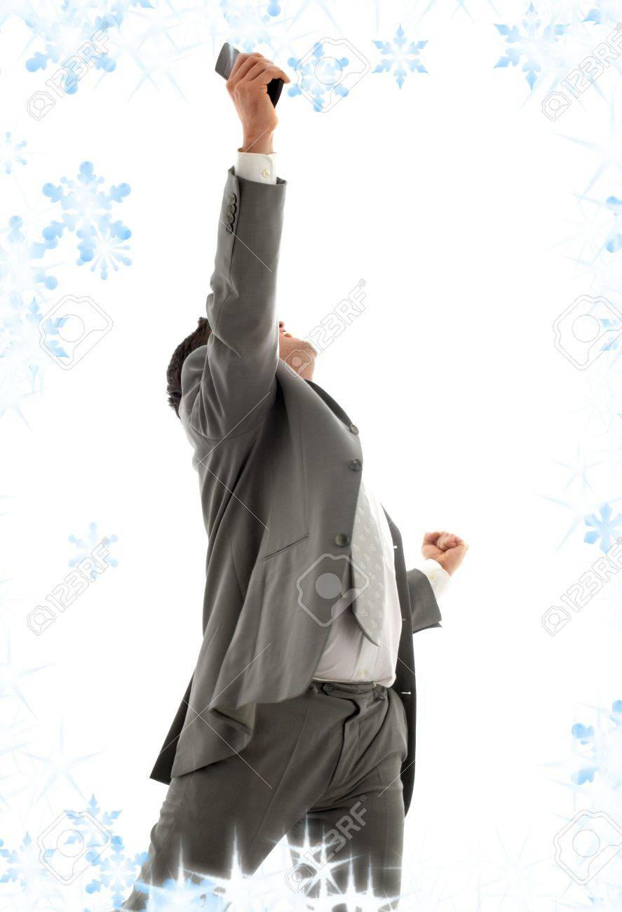 happy businessman with cellular phone and snowflakes Stock Photo - 3898363