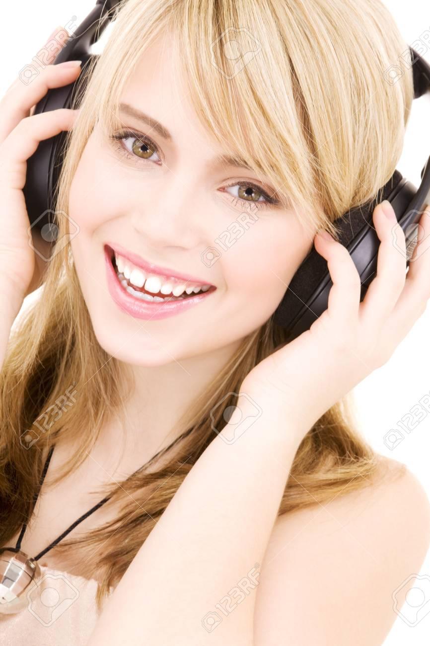happy teenage girl in headphones over white Stock Photo - 4303467