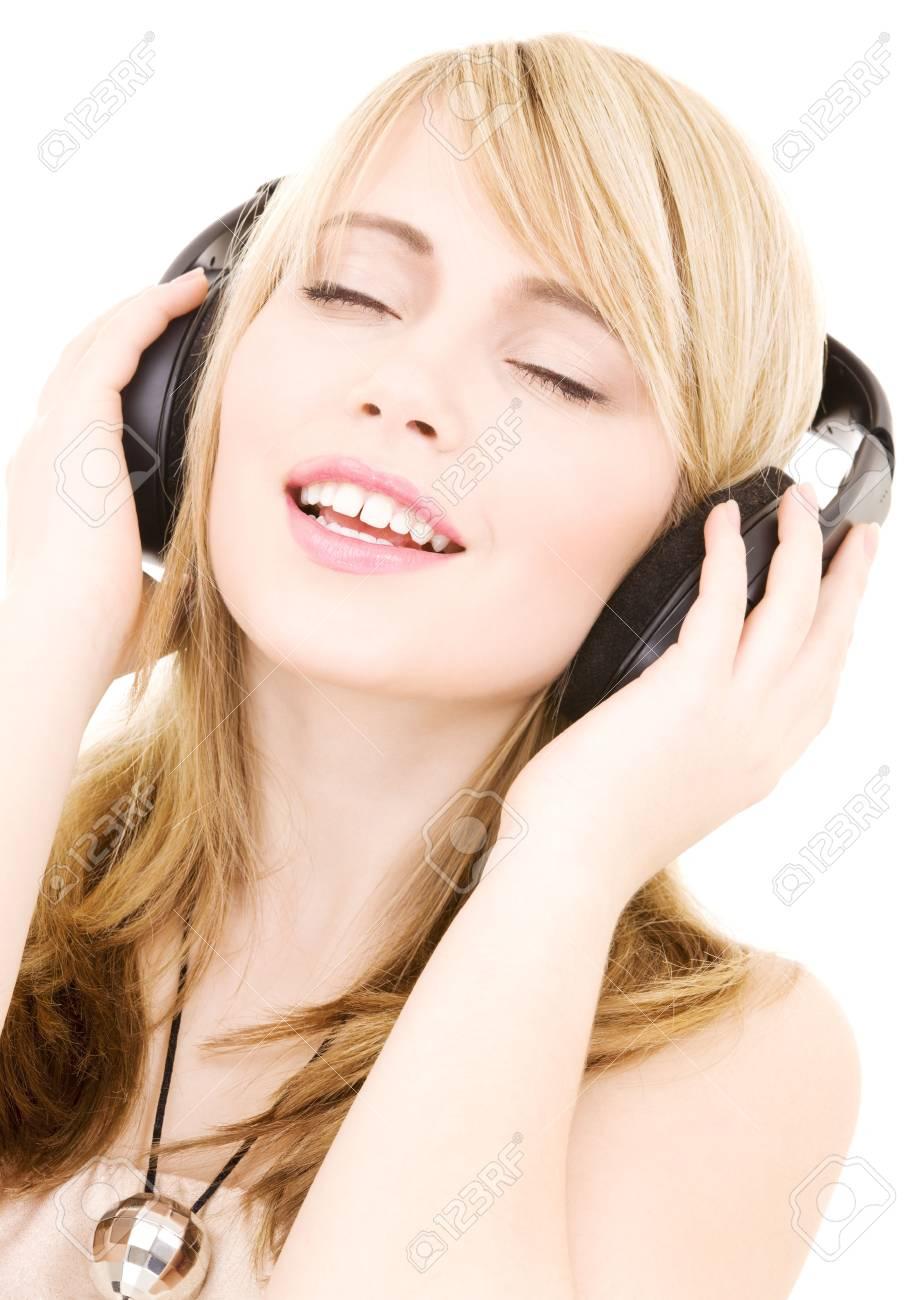 happy teenage girl in headphones over white Stock Photo - 4303466