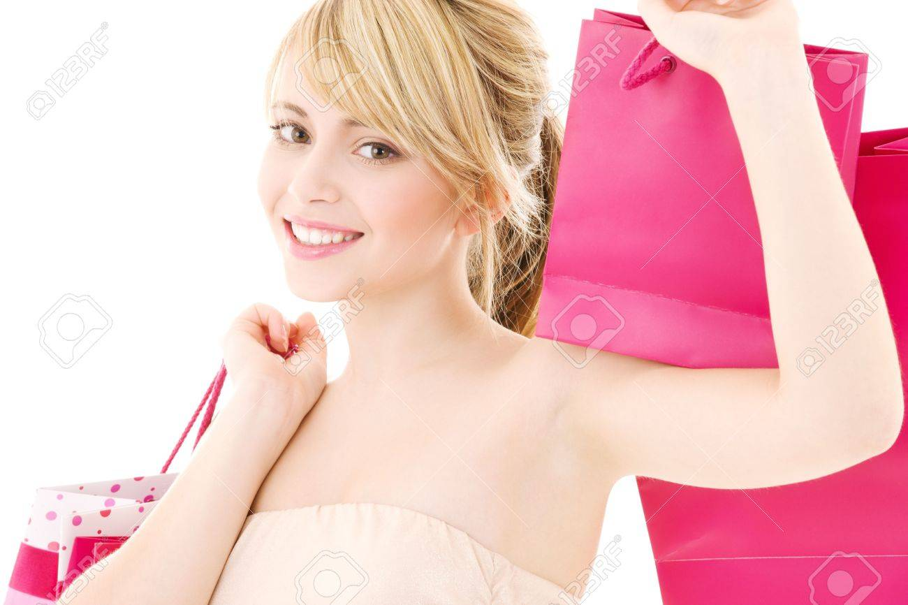 happy teenage girl with pink shopping bags Stock Photo - 4303485