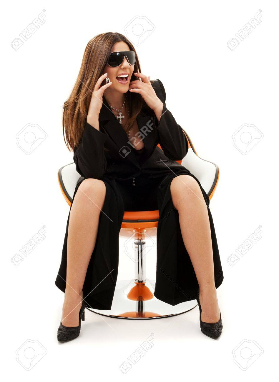 businesswoman with phone in orange chair over white Stock Photo - 4488490