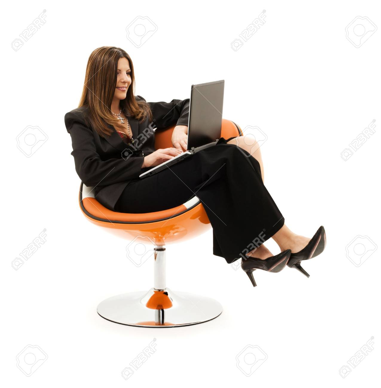businesswoman in chair with laptop computer over white Stock Photo - 4946509