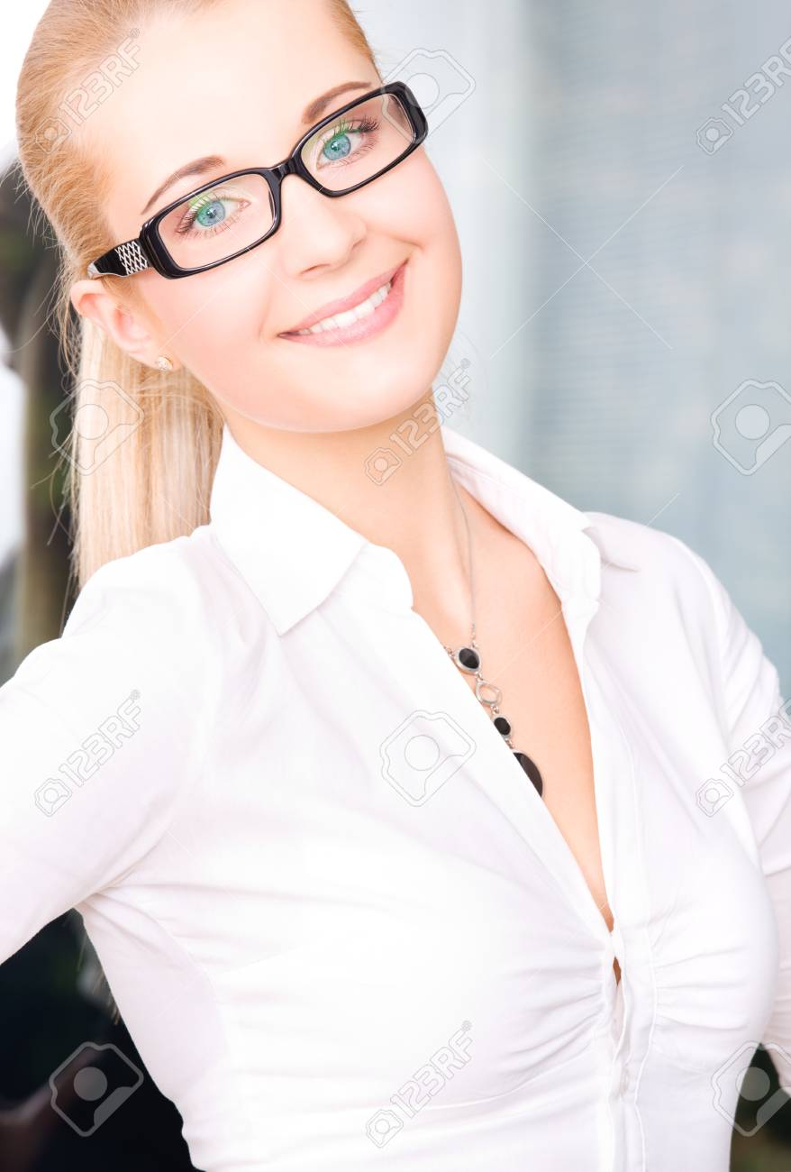 bright picture of lovely businesswoman in office Stock Photo - 5197042