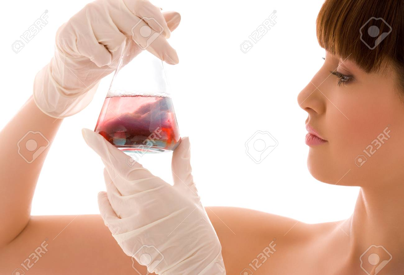 closeup of beautiful lab worker holding up test tube Stock Photo - 5196988