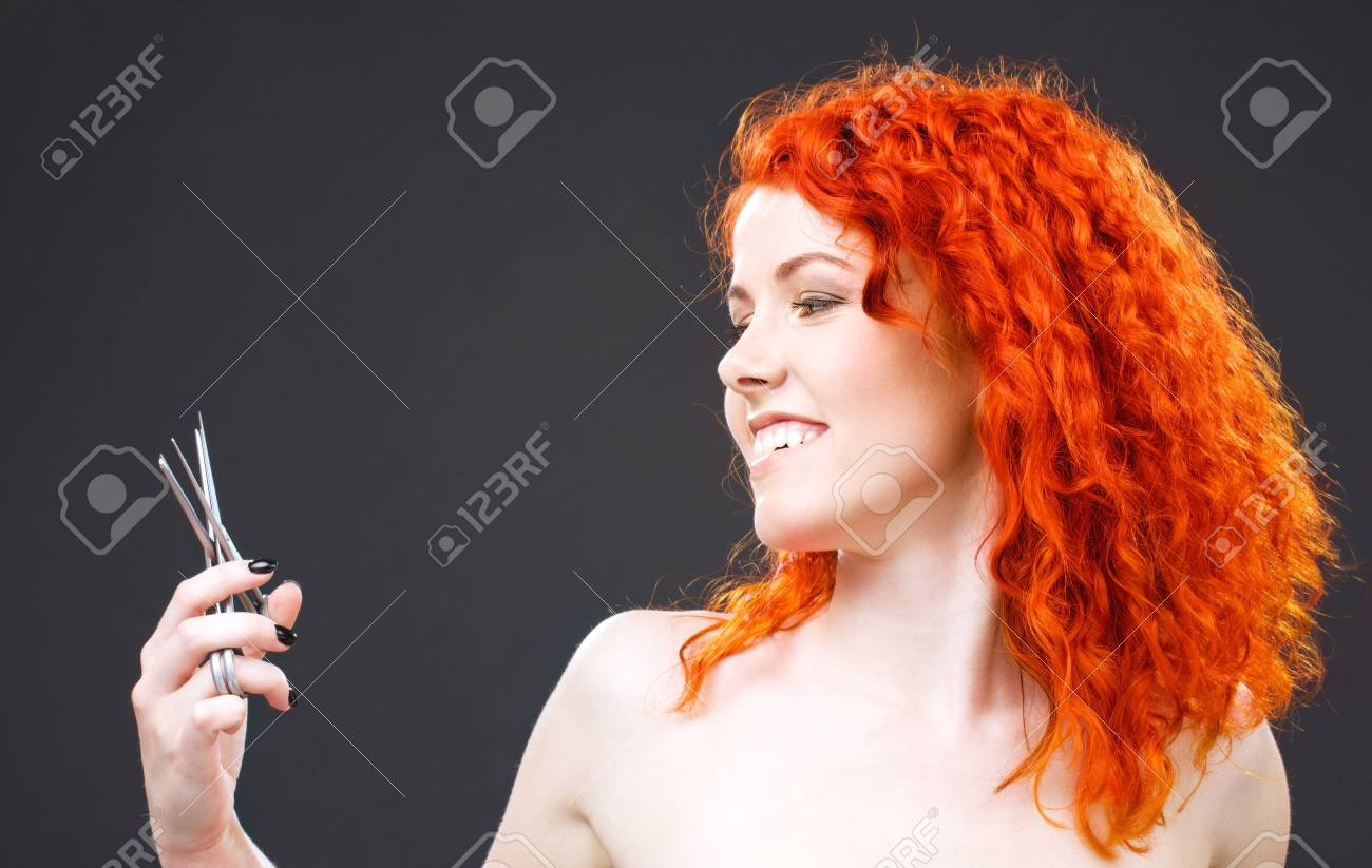 picture of lovely redhead with scissors over grey Stock Photo - 5197203