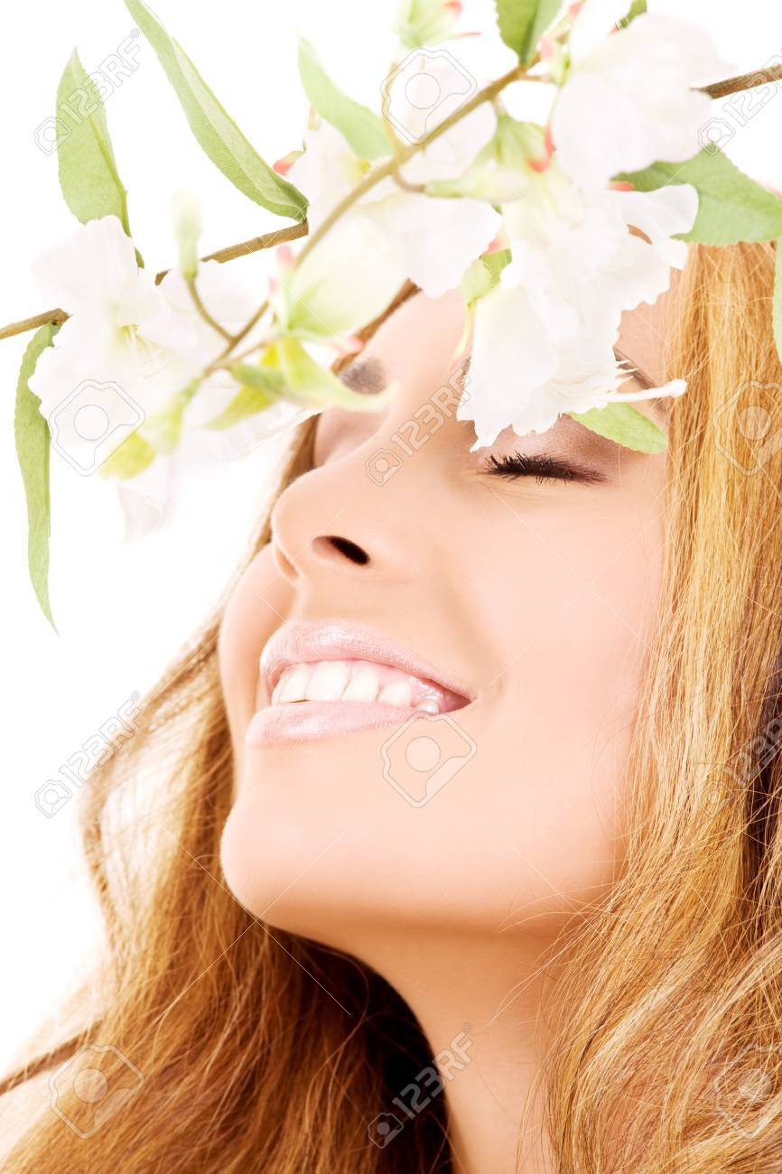 picture of happy woman with white flowers (focus on smile) Stock Photo - 5197160