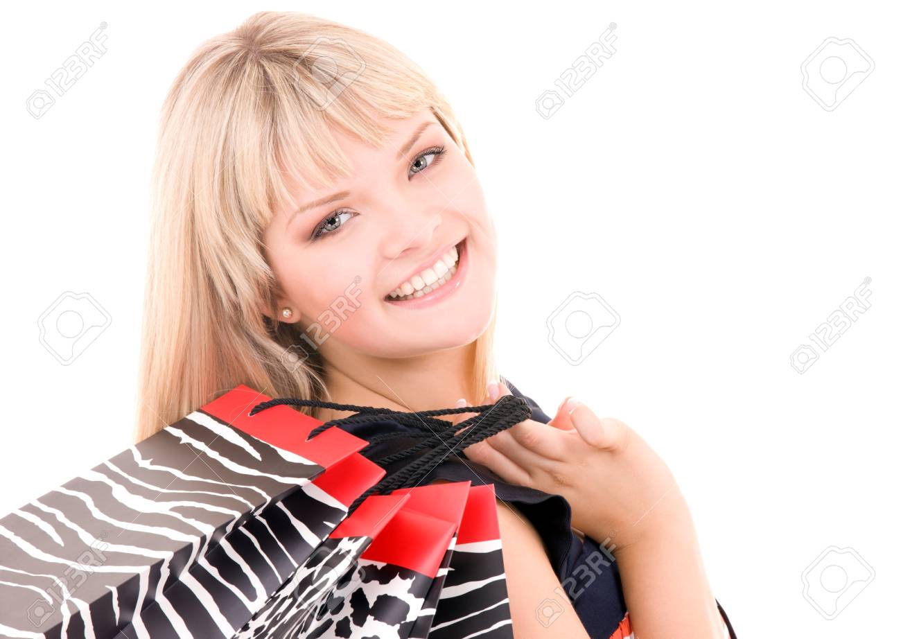 happy woman with shopping bags over white Stock Photo - 5348309