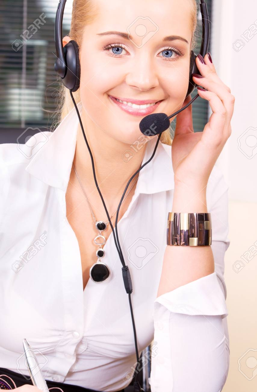 bright picture of friendly female helpline operator Stock Photo - 5676916