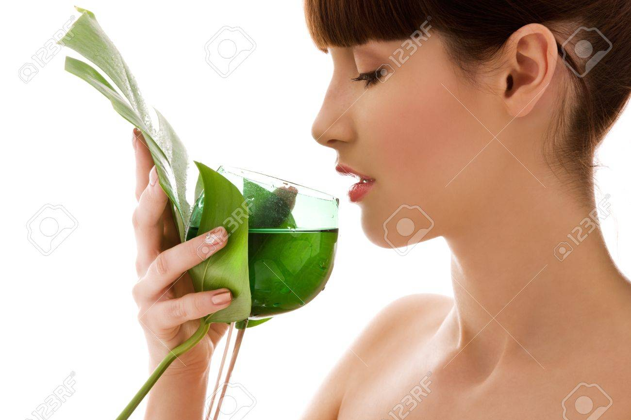 picture of woman with green leaf and glass of water Stock Photo - 5677043