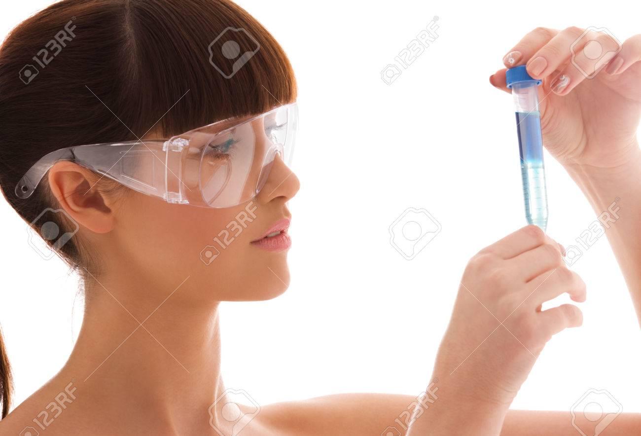 beautiful female lab worker holding up test tube Stock Photo - 5676865
