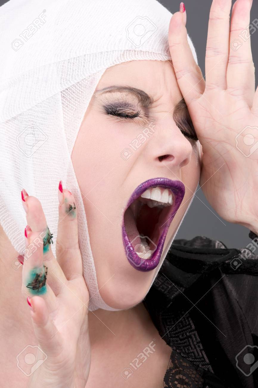 picture of screaming wounded woman face over grey Stock Photo - 5668597