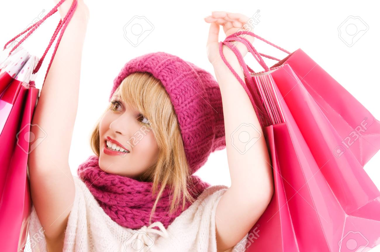 happy teenage girl in hat with pink shopping bags Stock Photo - 5685303