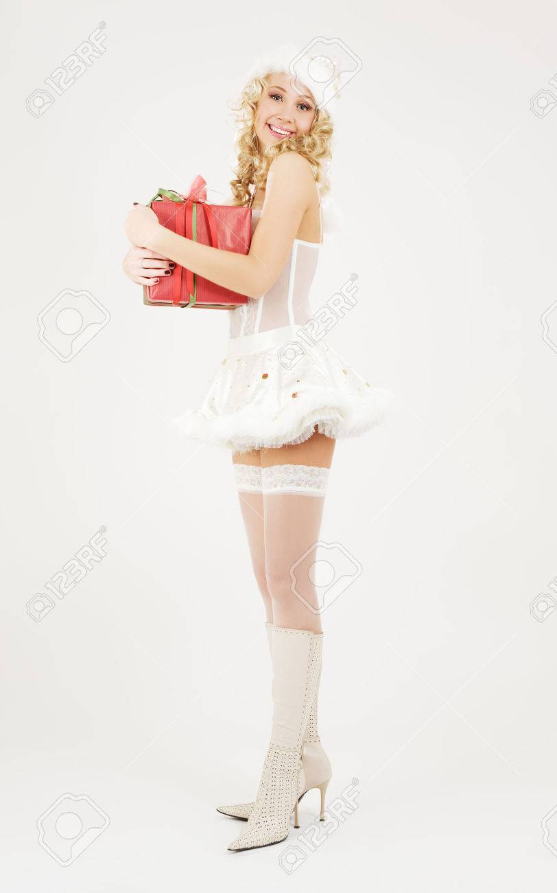 picture of cheerful santa helper girl with gift box Stock Photo - 5668911