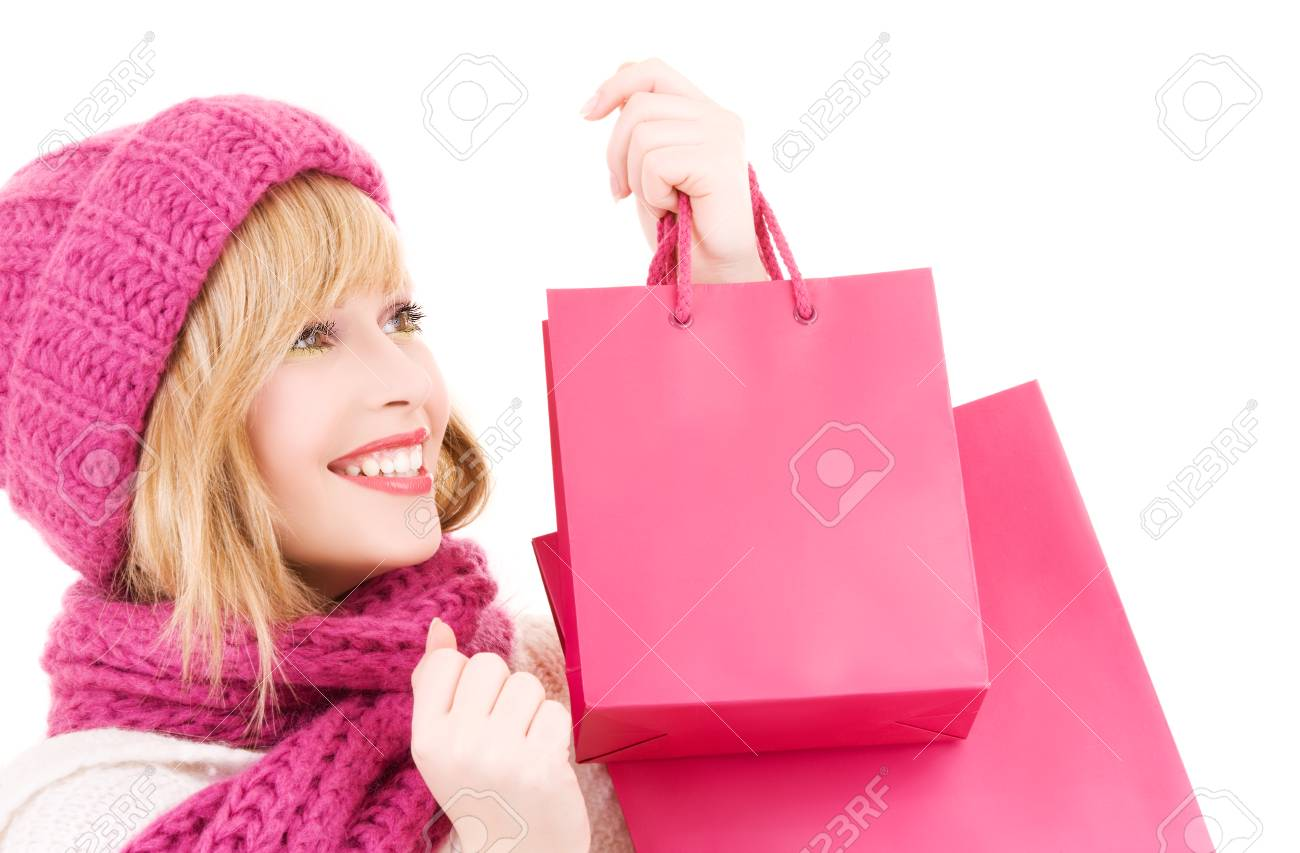 happy teenage girl in hat with pink shopping bags Stock Photo - 5685133