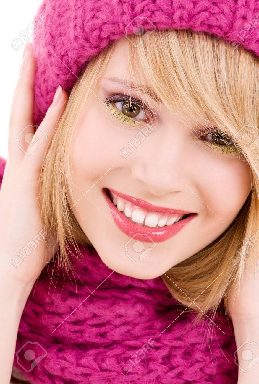 happy teenage girl in winter hat over white Stock Photo - 5685283