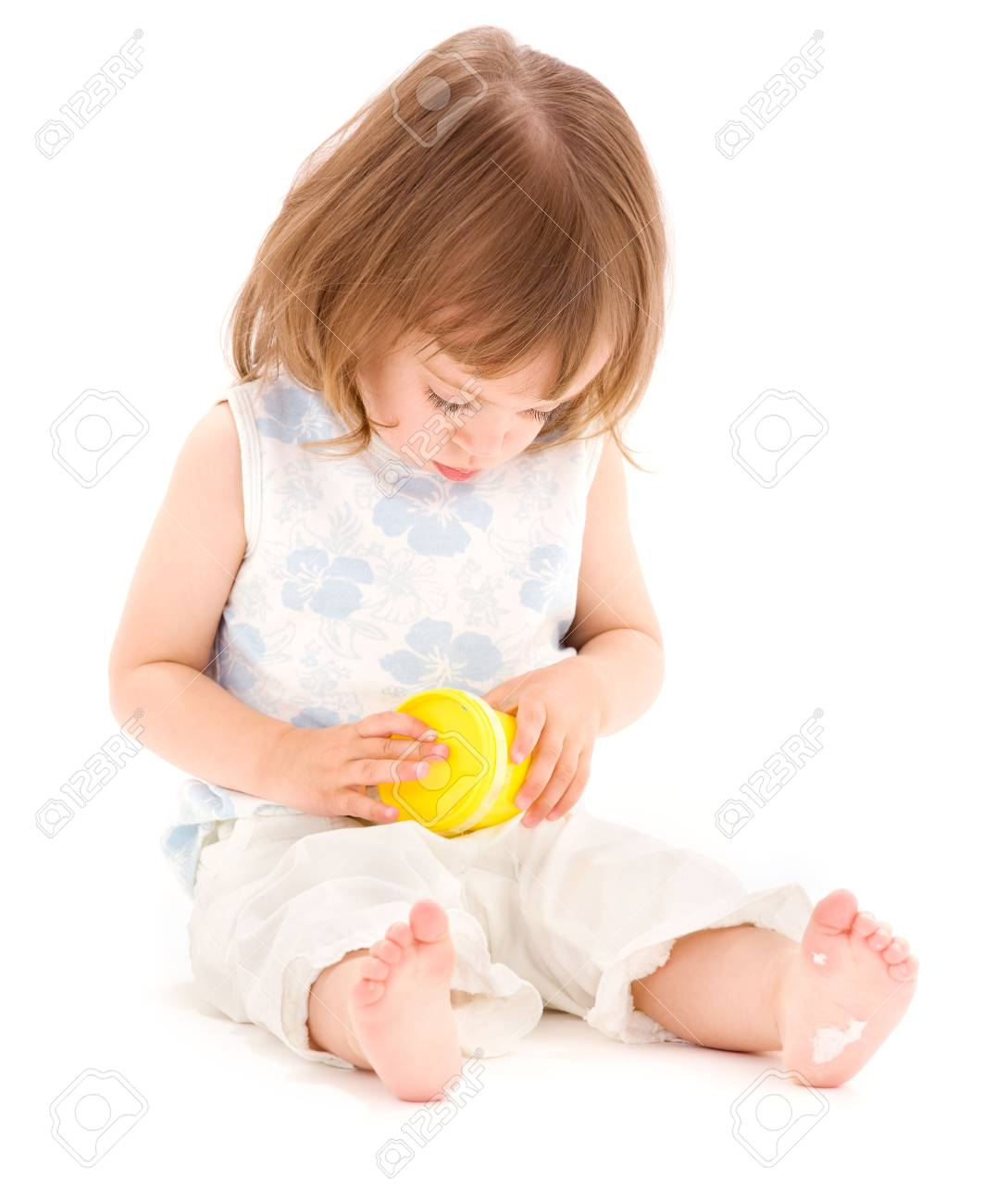 picture of little girl with yellow modelling foam over white Stock Photo - 5744692