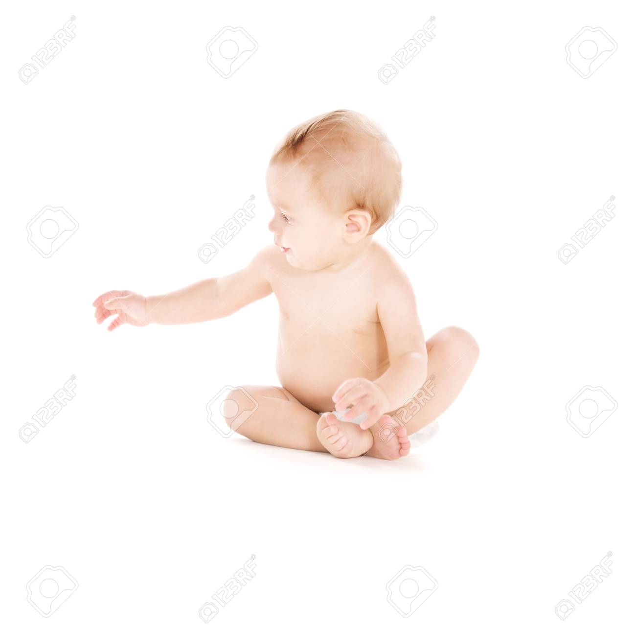 picture of sitting baby boy in diaper over white Stock Photo - 5847687