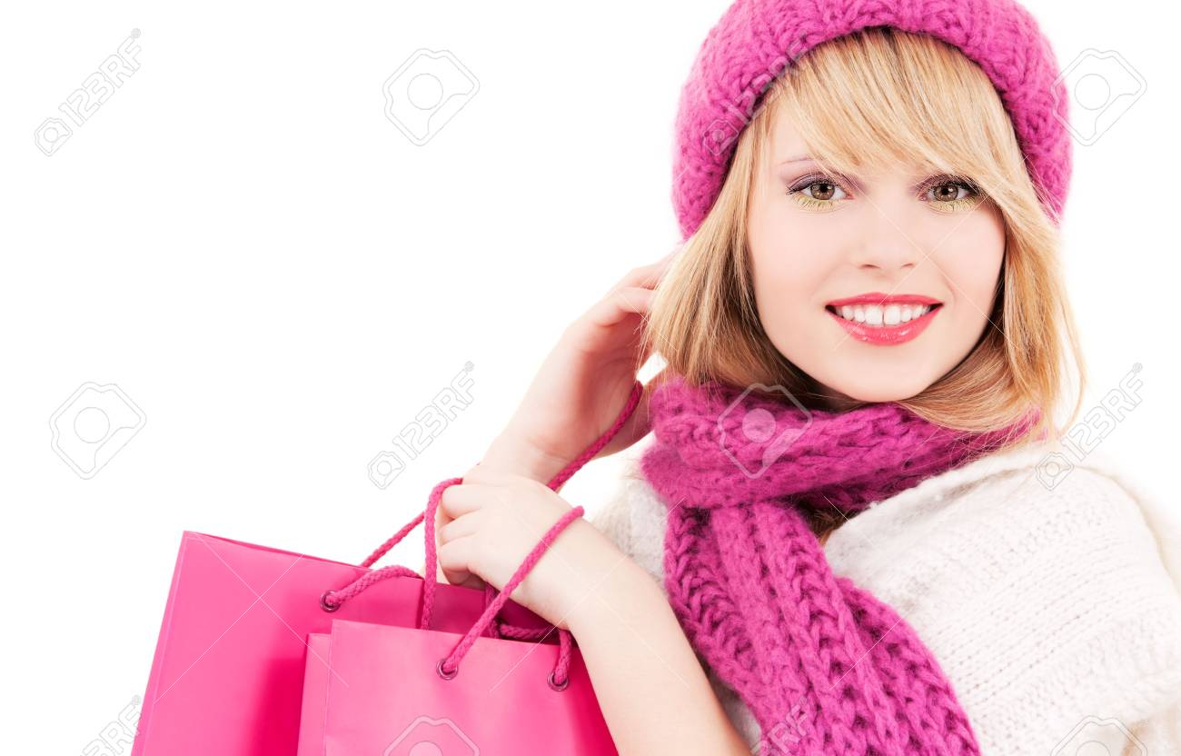 happy teenage girl in hat with pink shopping bags Stock Photo - 5847917