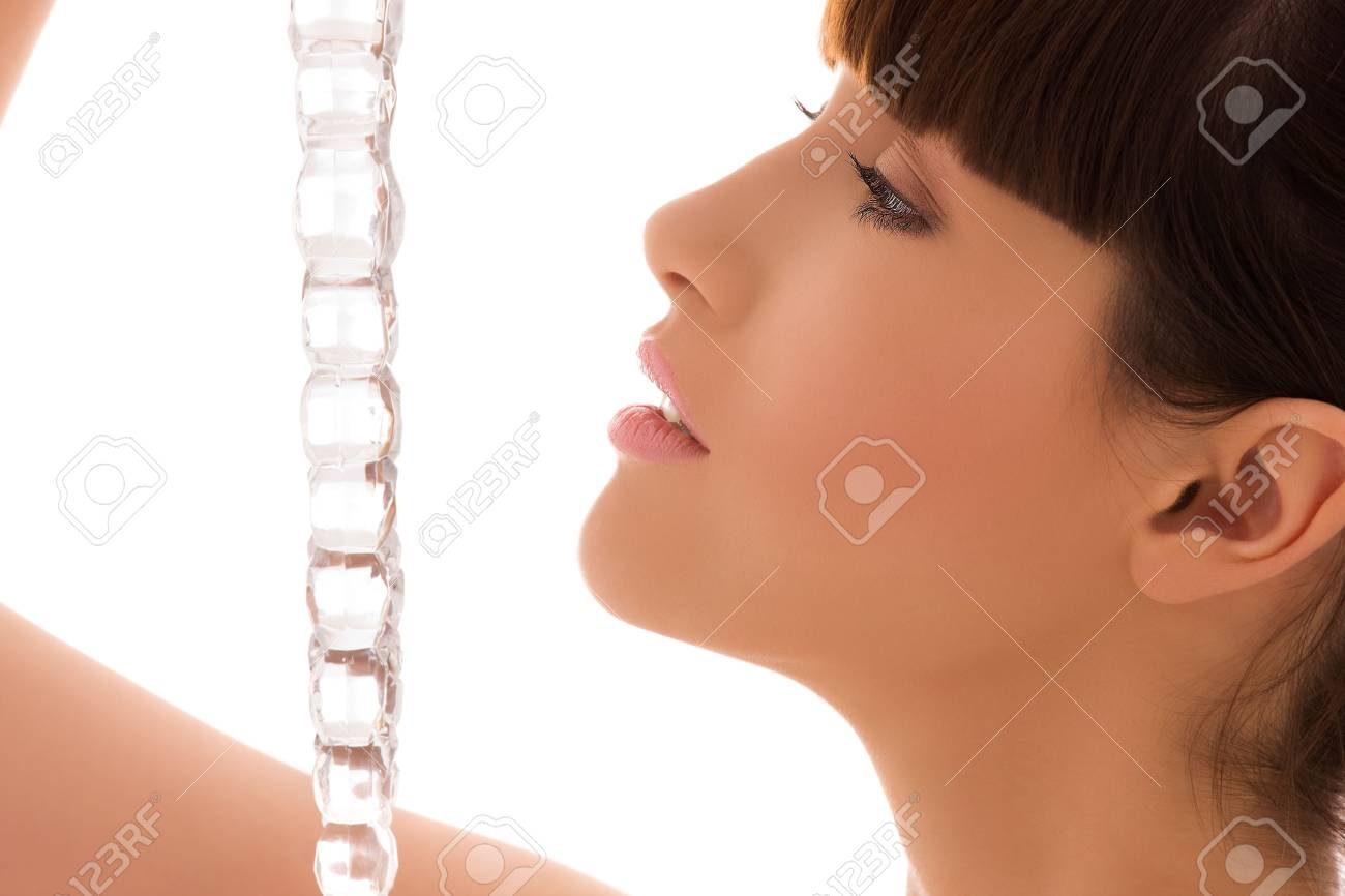 portrait of lovely woman with icicle over white Stock Photo - 5947567