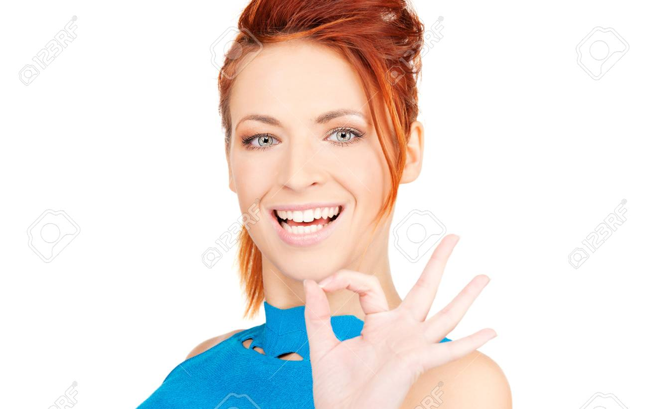 bright picture of lovely redhead showing ok sign Stock Photo - 6023900