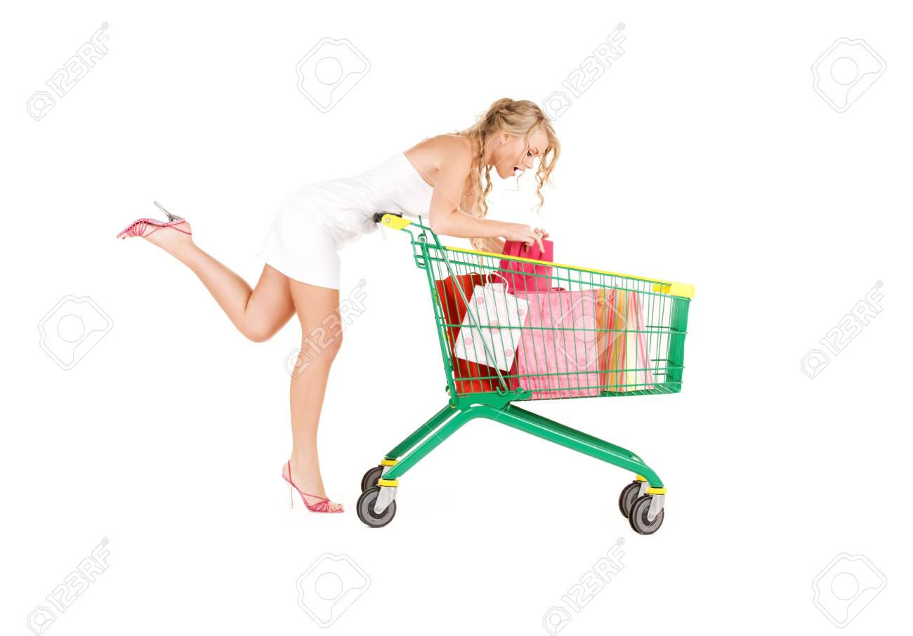 happy woman with shopping cart over white Stock Photo - 6136202