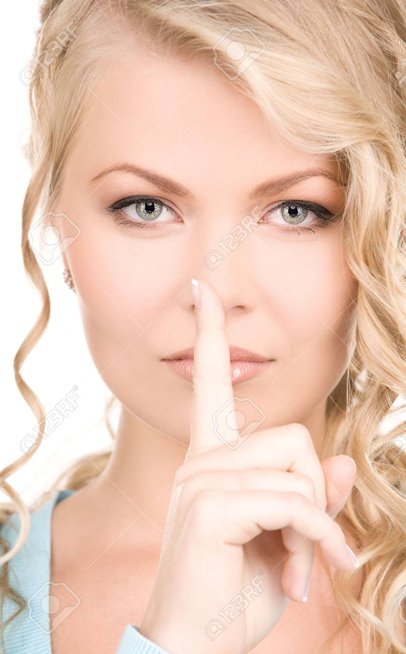 bright picture of young woman with finger on lips Stock Photo - 6136264