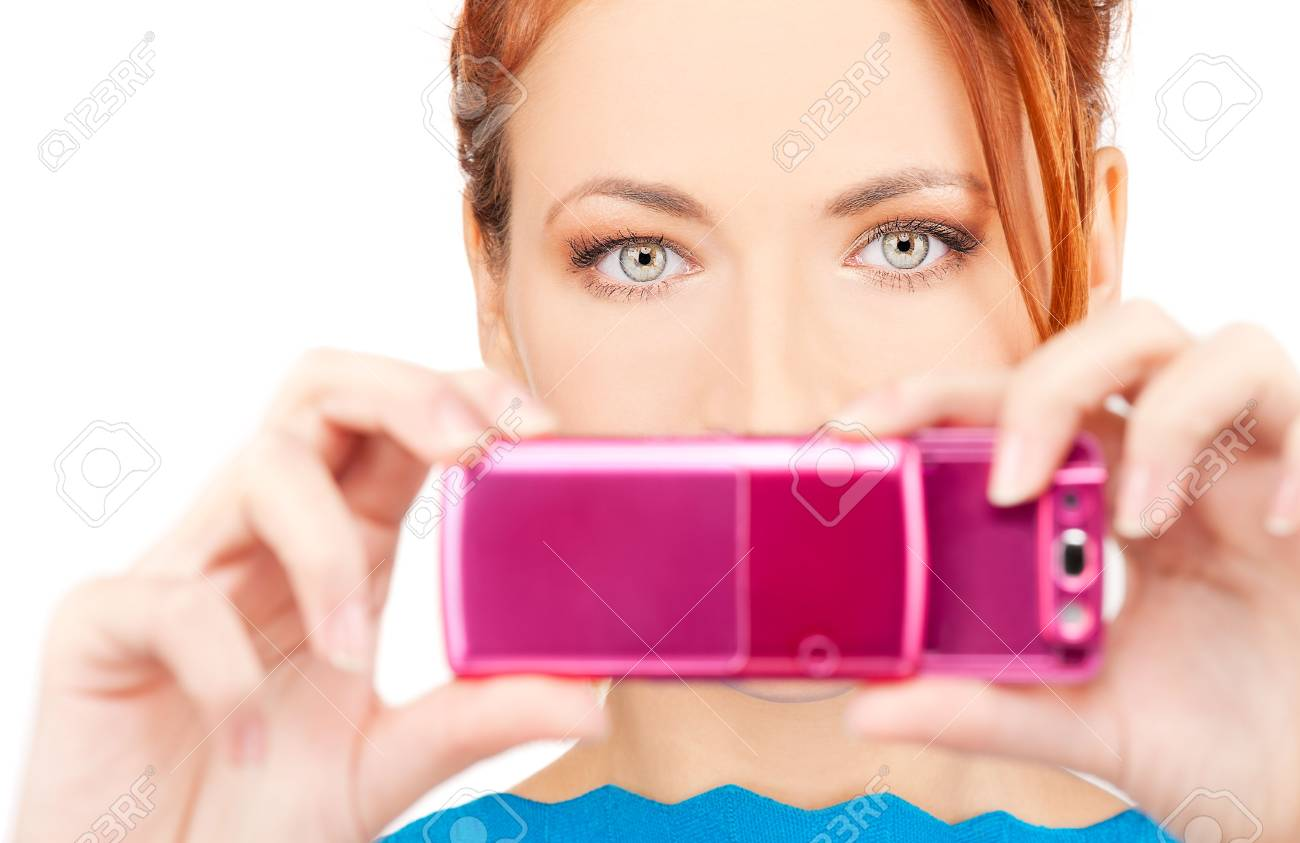 picture of redhead woman using phone camera Stock Photo - 6609884