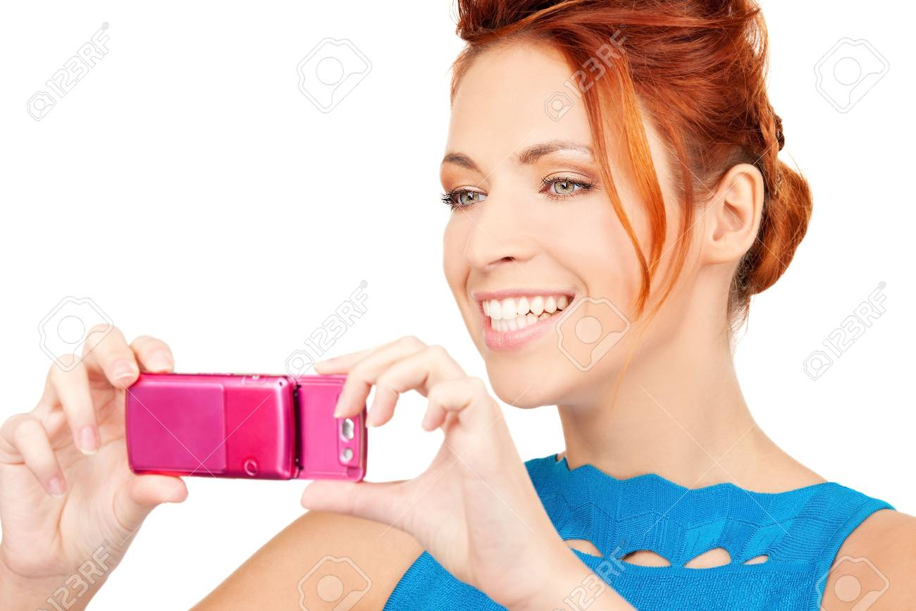picture of happy woman using phone camera Stock Photo - 6609986